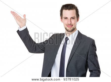 Caucasian businessman with hand showing with blank sign