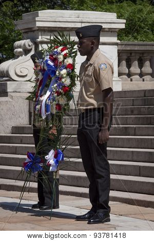 NEW YORK - MAY 25 2015: Two members of the Navy JROTC stand at attention next to a floral wreath at the Memorial Day Observance service at the Soldiers and Sailors Monument during Fleet Week NY 2015.