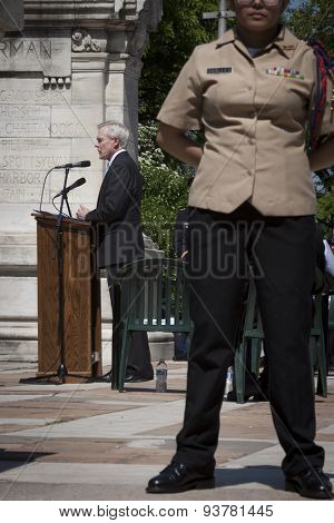 NEW YORK - MAY 25 2015: Secretary of the Navy (SECNAV) Ray Mabus at the podium with a JROTC cadet in foreground during the Memorial Day service at the Soldiers and Sailors Monument in Manahttan.