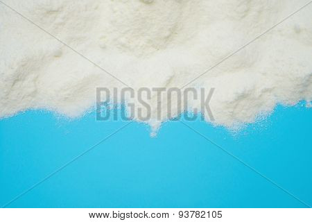 Powdered Milk On Blue Background With Copy Space