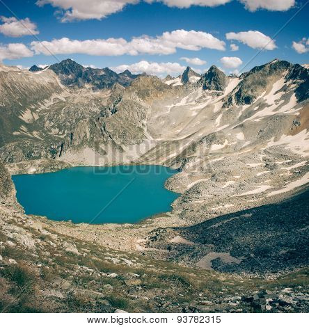 Scenery Of High Mountain With Lake And High Peak On A Clear Day