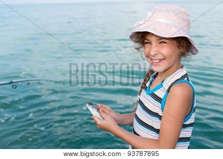 girl holds in hands freshly caught fish