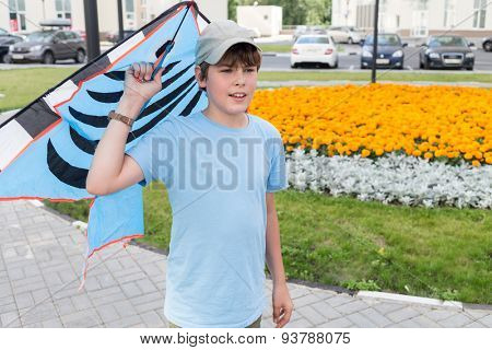 boy gets ready to launch a kite