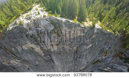 Forest on top of rocky mountain in Yosemite National Park at autumn sunny day. Aerial view