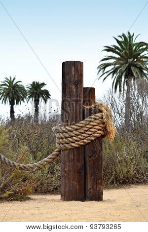 Old wooden docking post with rope