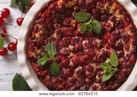 Homemade Cherry Clafoutis Close Up In A Dish. Horizontal Top View