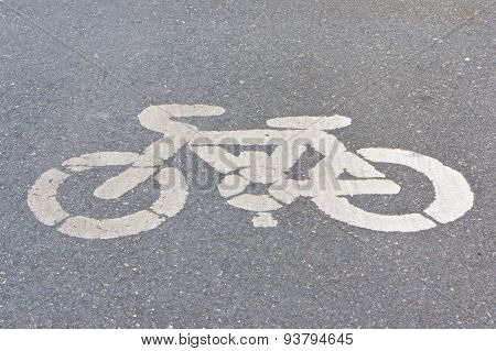 Old White Painted Sign Of Bicycle Lane