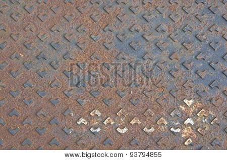 Rust Metal Cover Of Drain Water As Background Or Texture