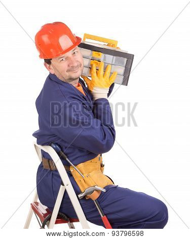 Worker on ladder with toolbox.