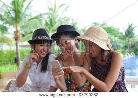 Portrait Of Asian Woman Friend Group Looking To Mobile Phone And Laughing With Happiness Emotion Use
