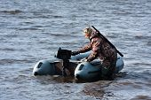 pic of hunter  - the hunter with motor rubber boat on the river - JPG