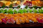 foto of buffet  - Closeup Japanese Cuisine -Buffet catering style Sushi Set in restaurant - salmon Maki Sushi and Nigiri Sushi