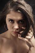 stock photo of thinkers pose  - pretty sad girl portrait on black background - JPG