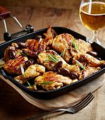 picture of kalamata olives  - Grilled chicken pieces with olives in a pan - JPG