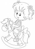 image of horse girl  - Happy little girl riding a toy horse - JPG