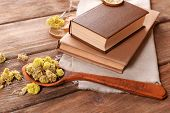 image of roughage  - Old books with dry flowers on table close up - JPG