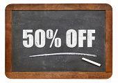 stock photo of fifties  - fifty percent off blackboard sign  - JPG