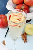 stock photo of cider apples  - Glass of apple cider with fruits and spices on table close up - JPG