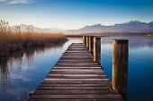picture of jetties  - Early morning at a jetty at lake Chiemsee - JPG