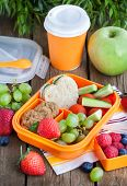 stock photo of lunch box  - Lunch box for kids with sandwich cookies fresh veggies and fruits  - JPG