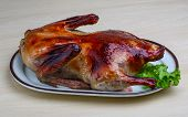 image of roast duck  - Roasted duck with salad leaves on the wood background - JPG
