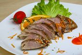 foto of roast duck  - Roasted duck breast with orange and sesame seeds