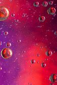 pic of psychedelic  - Psychedelic oil and water abstract background IN RED AND PURPLE - JPG