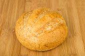 picture of buckwheat  - Round buckwheat bread on wooden bamboo board - JPG