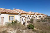 image of urbanisation  - Row of abandoned vacation homes in southern Spain - JPG