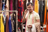 foto of tailoring  - Asian man tailor phone call talking fashion clothes dress designer working with fabric