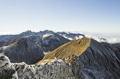 stock photo of breathtaking  - Top on a mountain ridge that is breathtaking - JPG