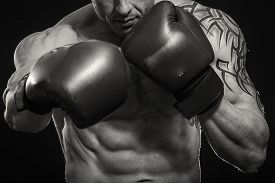 foto of boxing  - A man with a tattoo in red boxing gloves - JPG