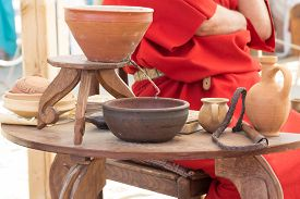 picture of scourge  - ancient Roman clay moonshine and utensils on the table - JPG