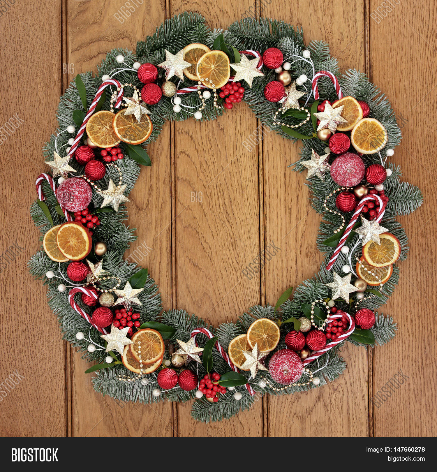 Fruit over the door christmas decoration - Christmas Wreath With Dried Fruit Candy Canes Gold Star And Red Baubles Holly