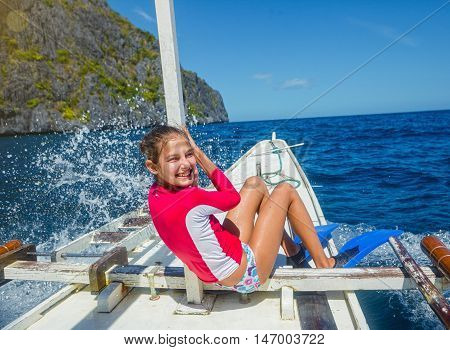 Beautiful young girl on a boat at a sunny summer day. Philippines