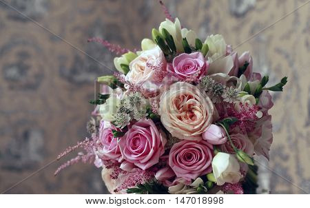 Beautiful wedding bouquet from pink roses close up