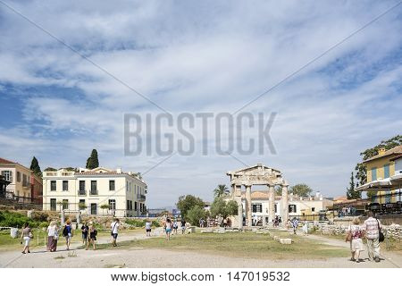 ATHENS, GREECE, SEPTEMBER 6,2016: Tourists visiting the archaeological site of Hadrian's Library, created by Roman Emperor Hadrian in AD 132 on the north side of the Acropolis of Athens.