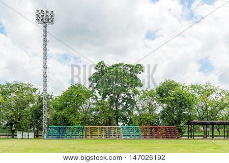 Metal grandstand empty seats in football field.