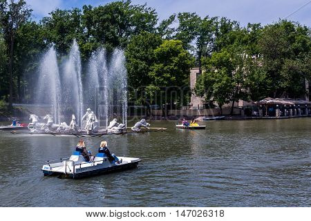 Almaty, Kazakhstan - May 22, 2016. People boating on the lake. Central City Park of the city of Almaty - one of the biggest in the city. Its area is 42 hectares. It was founded in 1856.