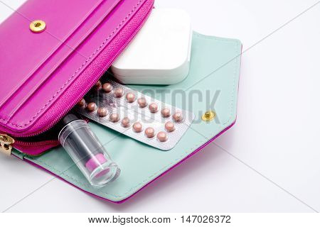 Blister Of Birth Control  Pills In Pink Purse.