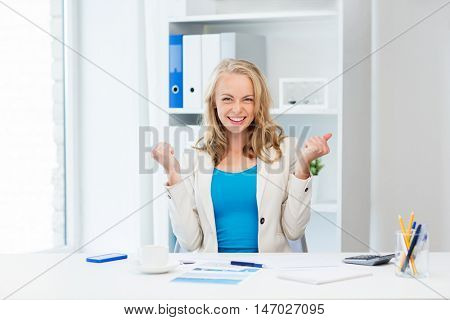 business, people and success concept - happy businesswoman celebrating triumph at office