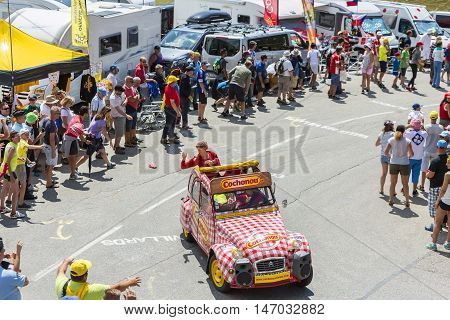Col du Glandon France - July 23 2015: Cochonou vehicle during the passing of the Publicity Caravan on Col du Glandon in Alps during the stage 18 of Le Tour de France 2015. Cochonou is an important French brand of short dry sausages.