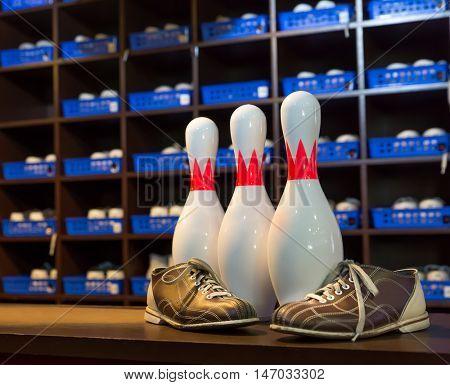 Bowling shoes and pins closeup