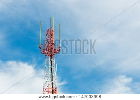 Telecommunication tower on blue sky and cloud background.