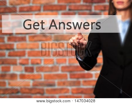 Get Answers - Businesswoman Pressing High Tech  Modern Button On A Virtual Background