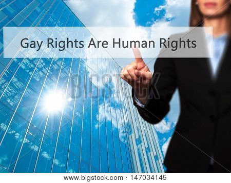 Gay Rights Are Human Rights - Businesswoman Pressing High Tech  Modern Button On A Virtual Backgroun