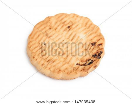 Single cookie with raisins isolated on white background
