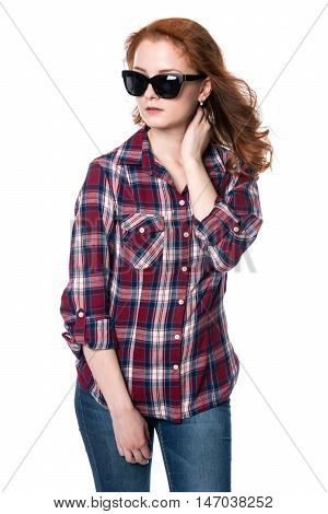 Beautiful girl in sunglasses looking away. Portrait of a young woman in a checkered shirt isolated on a white background