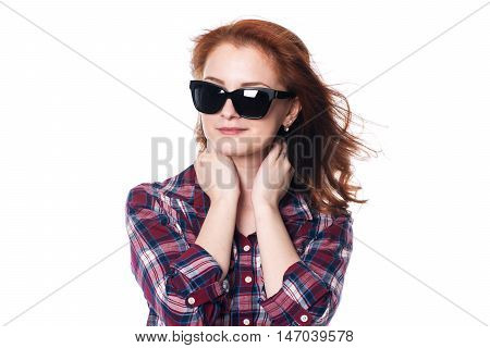 Smiling beautiful girl in sunglasses. Close-up portrait of a young woman in a checkered shirt isolated on a white background