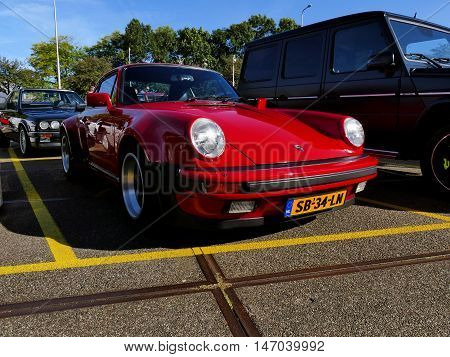 Amsterdam, The Netherlands - September 10, 2016: Red Porsche 911 Turbo 1983 On Display During Cars &